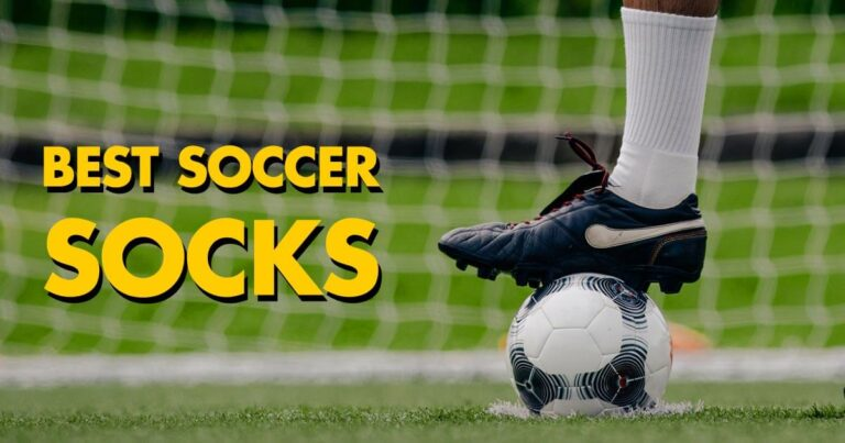 Man showing his soccer socks with his cleat on a soccer ball