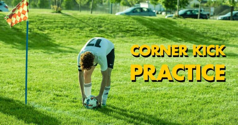 Male soccer player placing the ball in the corner kick are and getting ready to take the corner kick