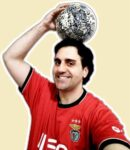 Guy wearing an SL Benfica jersey holding soccer ball over his head