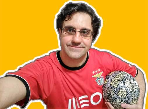 Guy wearing an SL Benfica jersey and a soccer ball under his arm